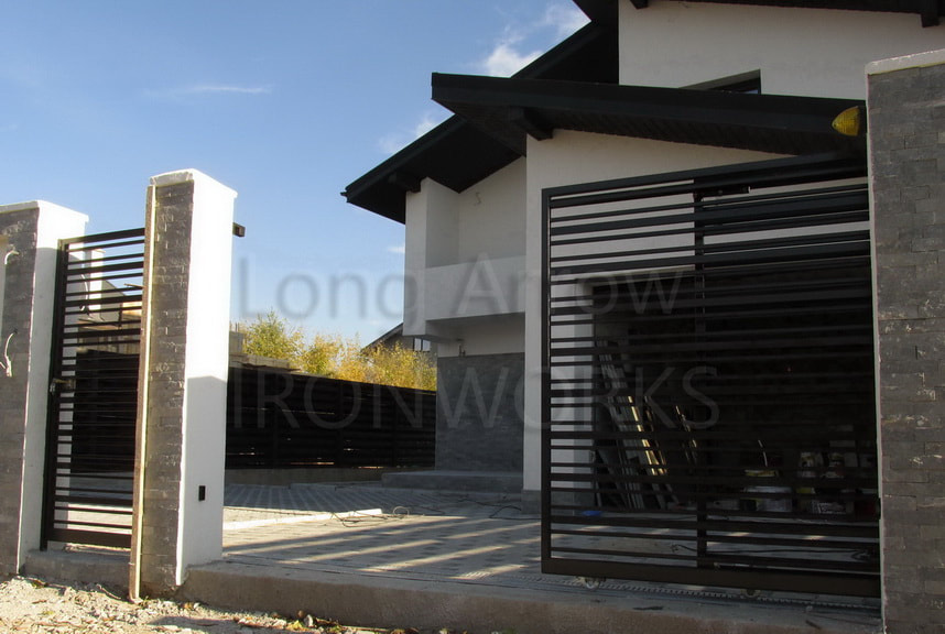 telescopic metal gate installation example