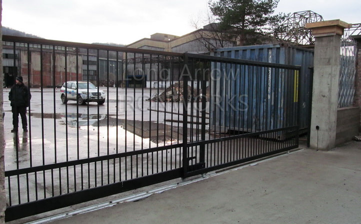 automated telescopic metal gate